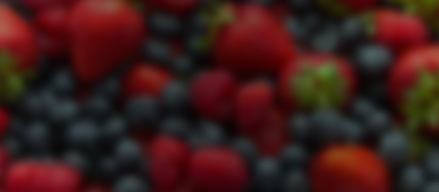 strawberries and blueberries blurred