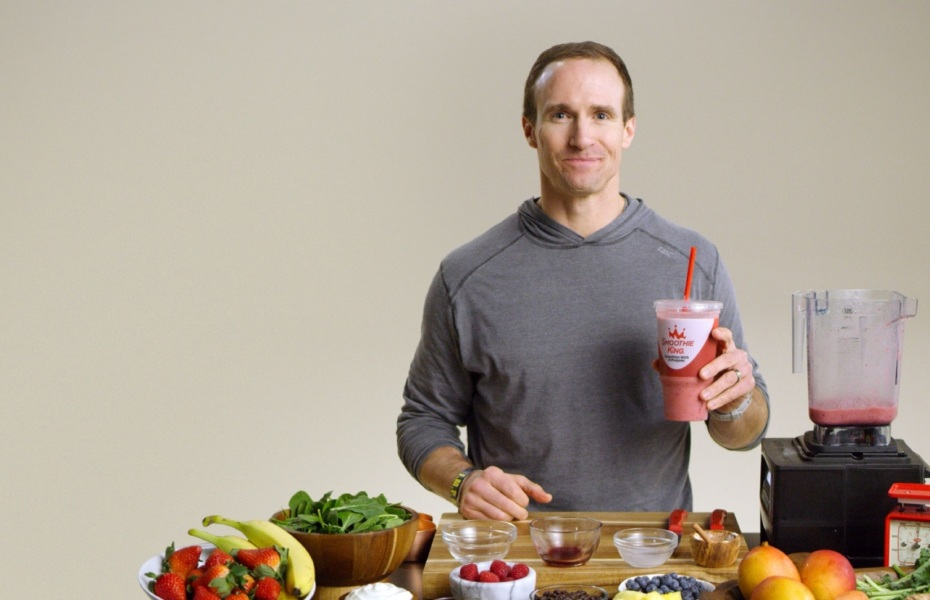 Drew Brees holding a smoothie that he made