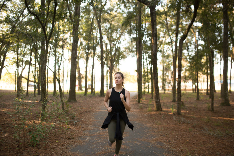 Woman running in park during the fall