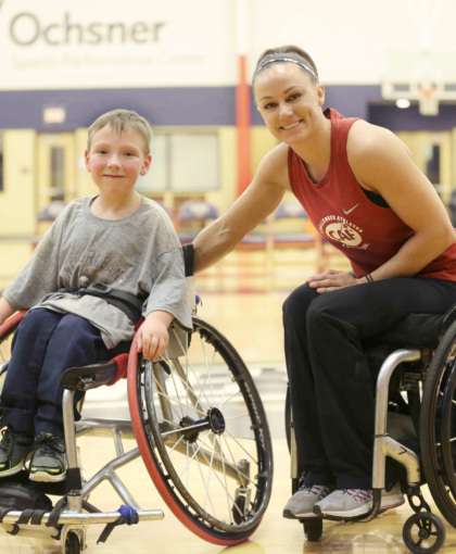 boy and woman athletes in wheelchair